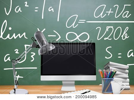 Digital composite of Computer Desk foreground with blackboard graphics of formulas