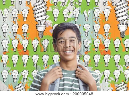 Digital composite of Student in front of colorful light bulbs graphics