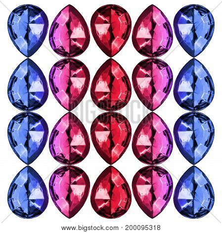 Group of colorful faceted gemstones isolated over white