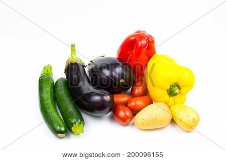 Raw food vegetables isolated on white background with copy space pepper eggplant tomato potato and zucchini close up