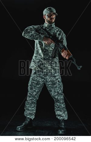 Soldier In Military Uniform With Rifle