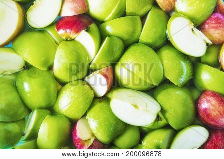 Apple sliced. Soaked apple in water. Abstract pattern background.