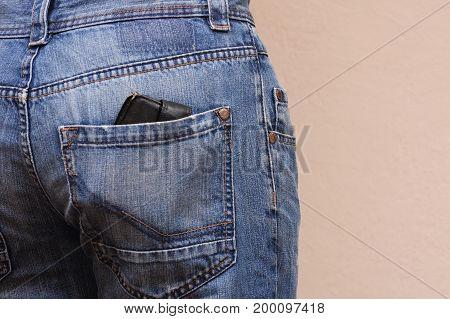 Wallet in jeans pocket. Wallet get out from back pocket