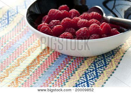 Fresh Raspberries On Colorful Tablecloth