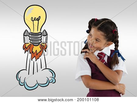 Digital composite of Schoolgirl with colorful light bulb rocket graphics