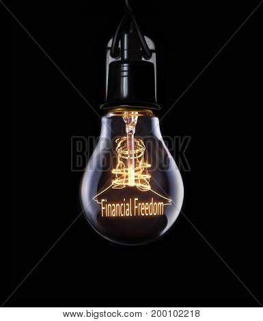 Hanging lightbulb with glowing Financial Freedom business concept.