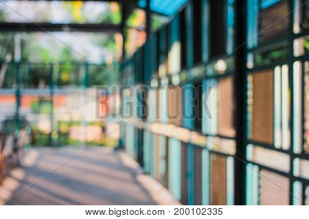 Blurred indoor restaurant background with steel door cage.