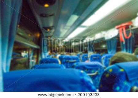blur of bus interior with tourist at night for background