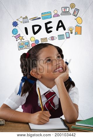 Digital composite of Schoolgirl writing at desk with idea graphics