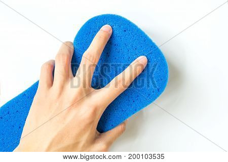 close-up of Hand holding blue Sponge for Car Wash isolated on white background