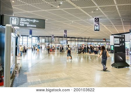 TOKYO, JAPAN - JUNE 18 2017 : passenger walking to check-in counter in departure terminal 1 at narita international airport
