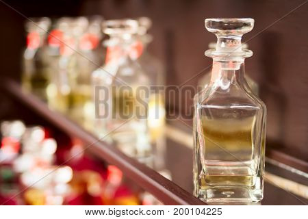 The Bottles With Spirits On A Show-window Of Shop