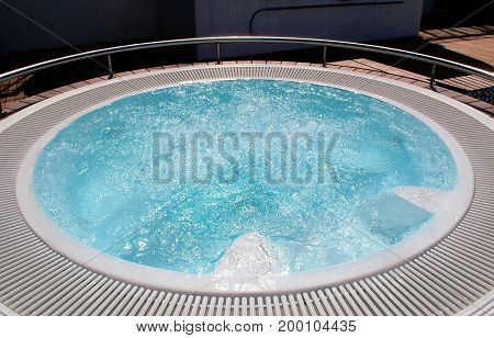 Round outdoor Jacuzzi in a cruise ship