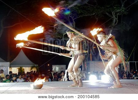 SAIPAN, CNMI--A group of male cultural dancers perform with fire and burning poles on stage at the annual Flame Tree Arts Festival in Saipan on April 2016.