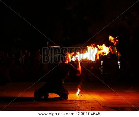 SAIPAN, CNMI--A female fire swallower impresses the audience at one of the regular weekly street markets in Garapan, Saipan in December 2016.