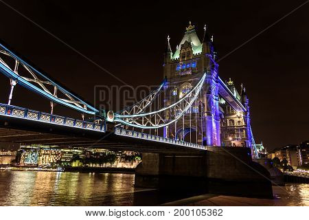 view of Tower Bridge over the River Thames at night London UK England selective focus