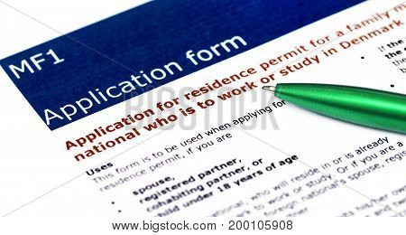 Family Visa application form of Denmark details with green ballpoint