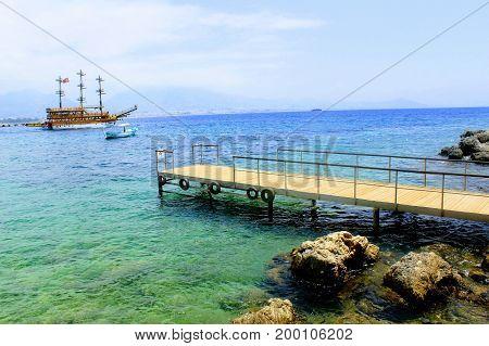 A small pier for pleasure boats and fishing boats (Alanya, Turkey).