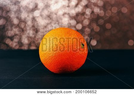 Fresh Orange On Grey Table, Sparkling Background
