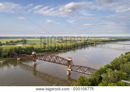 Historic railroad Katy Bridge over Missouri River at Boonville with a lifted midsection and visitor observation deck  - aerial view poster