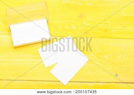 Business Card Holder On Bright Yellow Wooden Background