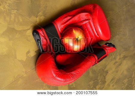 Sport Equipment And Fruit On Dark Beige Marble Background