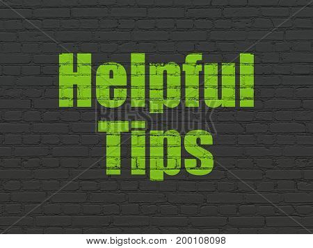 Studying concept: Painted green text Helpful Tips on Black Brick wall background