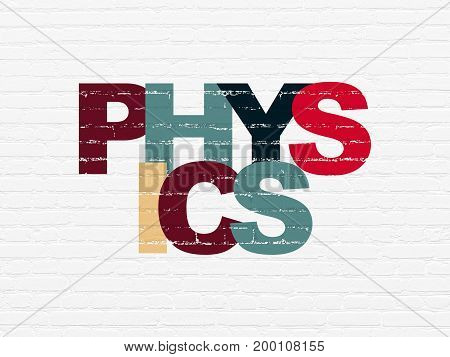 Studying concept: Painted multicolor text Physics on White Brick wall background