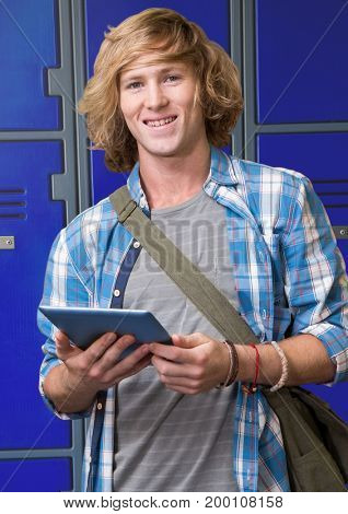 Digital composite of male student holding tablet in front of lockers