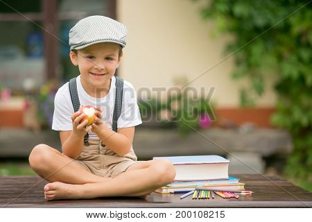 Boy, Writing His Homework From School, Drawing And Writing In His Notebook, Learning New Things