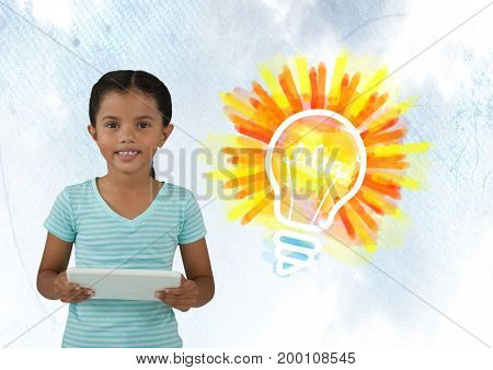 Digital composite of Girl on tablet with colorful light bulb idea