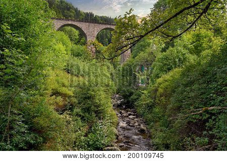 stone arch train trestle with creek in Black Forest Germany
