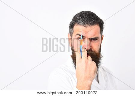 Physician Looking On Needle. Bearded Man With Stylish Haircut