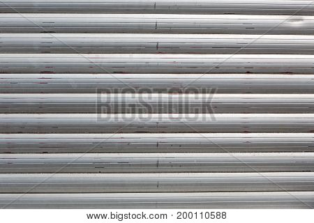 structured metal shutters as background colored shiny silver