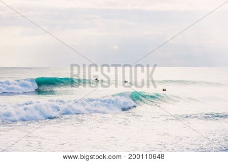 Surfers and blue waves. Surfing in blue ocean