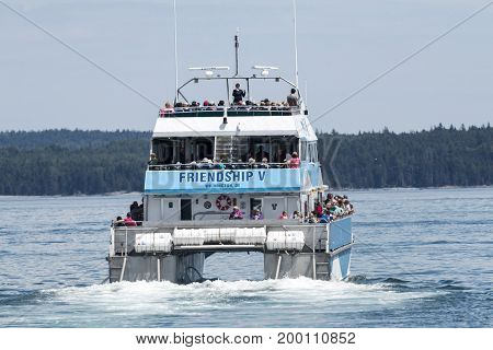 Bar Harbor Maine USA - 28 July 2017: The Friendship V catamaran of the Bar Harbor Whale Watch Company leaving the docks with passengers on a whale watching tour.