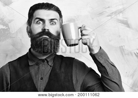 Bearded Brutal Caucasian Hipster With Coffee Cup