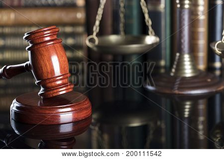 Law symbols.  Gavel of the jugde and scale of justice in the court library.
