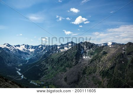 Top View Of The Valley Between The High Mountains