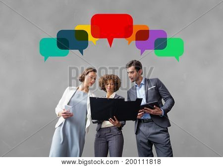 Digital composite of Business people with speech bubbles against grey background