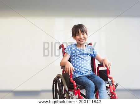 Digital composite of Disabled girl in wheelchair in school