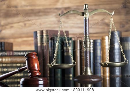 Law and justice. Judge's gavel, books and scale on glass table table.