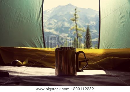 Aluminum Thermos Mug In A Tent On The Beautiful Backdrop Of The Mountains,
