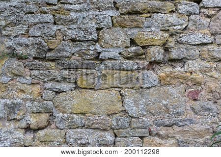 Background. Stone and Rocks wall with irregular structure.