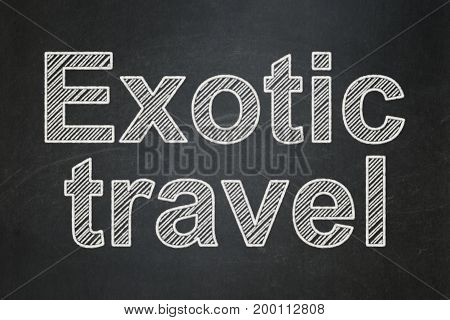 Tourism concept: text Exotic Travel on Black chalkboard background