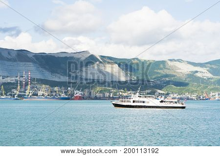 Novorossiysk, Russia - July 07, 2017: Tourist boat returns from a walk to the port of Novorossiysk in Russia