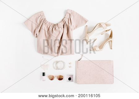 Woman fashion clothes and accessories collage on white background. Flat lay top view feminine background.