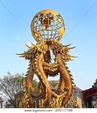 Feb 7, 2017. Halong Bay, Vietnam. HaLong  Ocean Park Sculpture with Dragons holding the Globe.