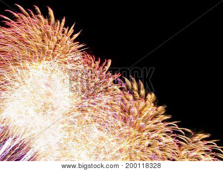 Colorful fireworks with multiple bursts against dark sky