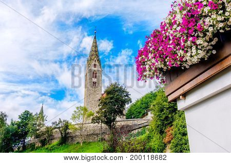 Villandro (Villander) - Trentino Alto Adige - Sudtirolo - Italy - colorful summer bell tower flowers on balcony